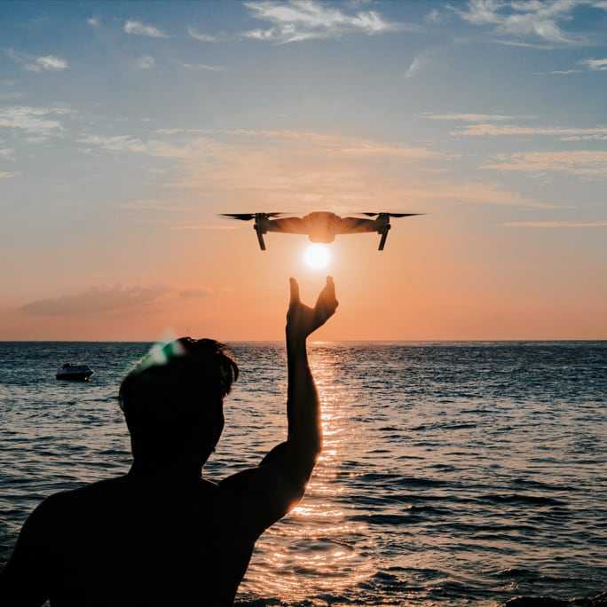 Man with drone at sunset in Bali