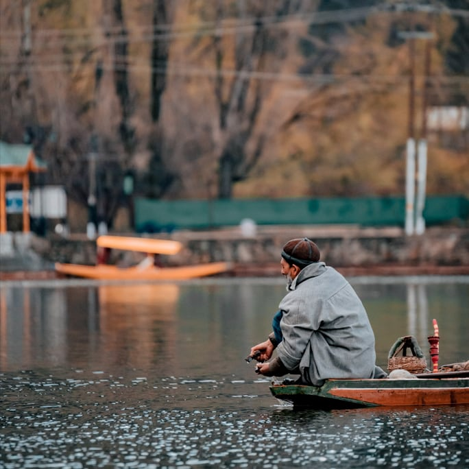 Man in boat at Kashmir Dal Lake