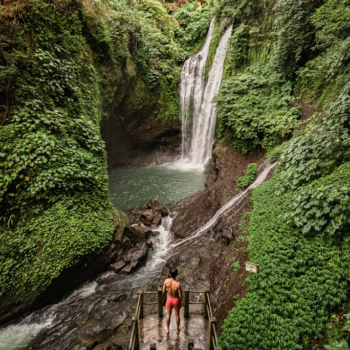 Man looking at waterfall in Bali